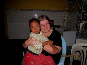 Joana hugs a boy who lost his parents and was living on his own. He now lives at a friend's orphanage.