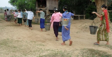 carrying water in buckets
