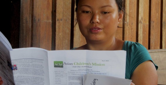 Student reading ACM newsletter