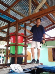 Eric Malave, founder and leader of A Generous Life, inspects an aquaponics system built in Myanmar.  Eric and his team hope to build an aquaponics system at Hope Children's Home near Yangon.